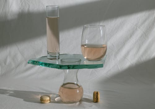 Composed glassware with wine and macaroons