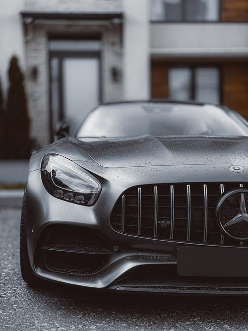 Silver Mercedes Benz Car in Front of White Building