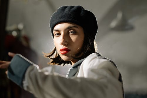 Close Up Shot of a Woman Wearing Beret