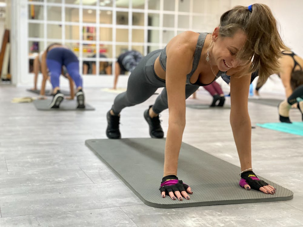 Woman in Gray Sports Bra and Black Leggings Doing Push Up