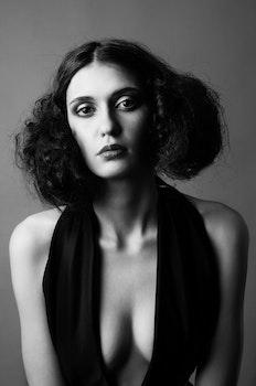 Grayscale Photo of Woman in Black Scoop Neck Halter Dress