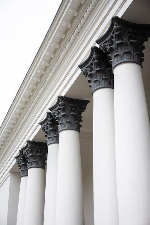 White Concrete Pillar With Black Statue