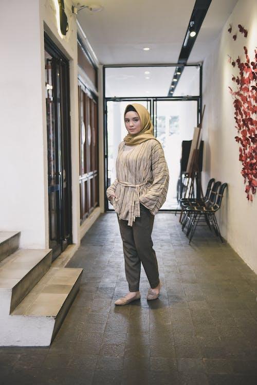 Woman in Beige Hijab Standing Near Door