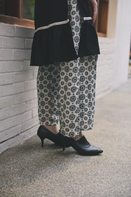 Woman in Black and White Polka Dots Dress and Black Leather Booties