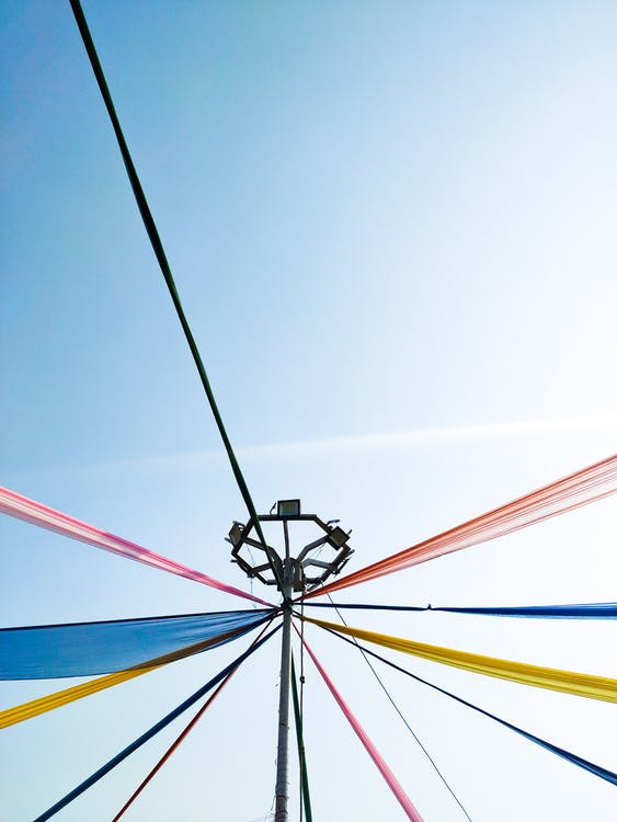 Traditional maypole with colorful ribbons