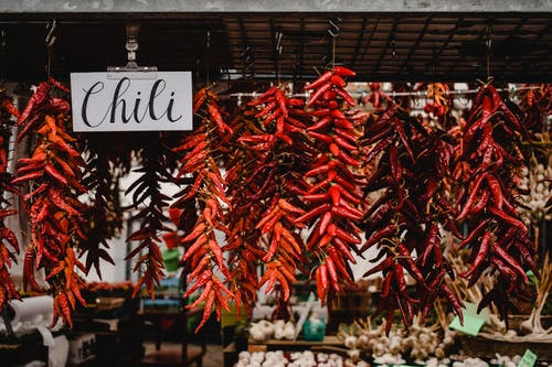 Red Chili on Brown Wooden Table