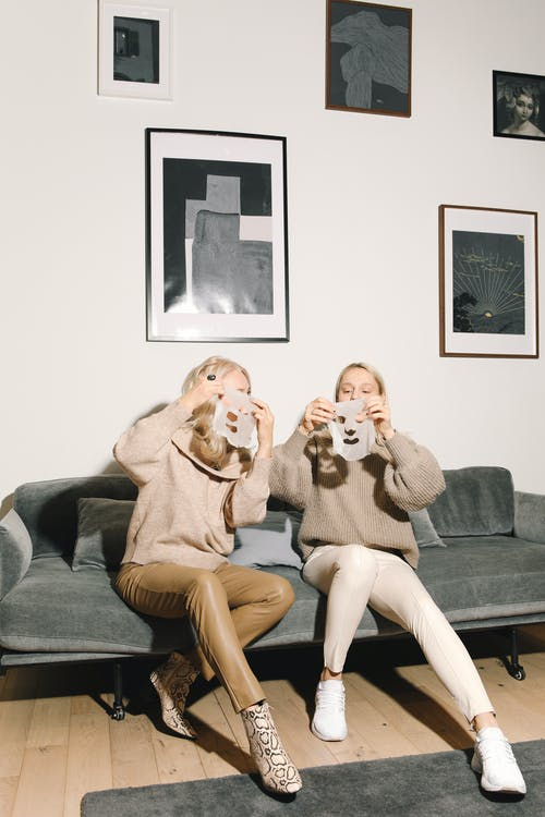 Mother And Daughter Having Fun With Masks