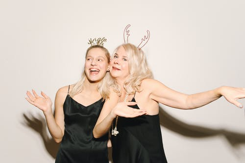 Mother And Daughter in Black Sleeveless Dress And Headdress