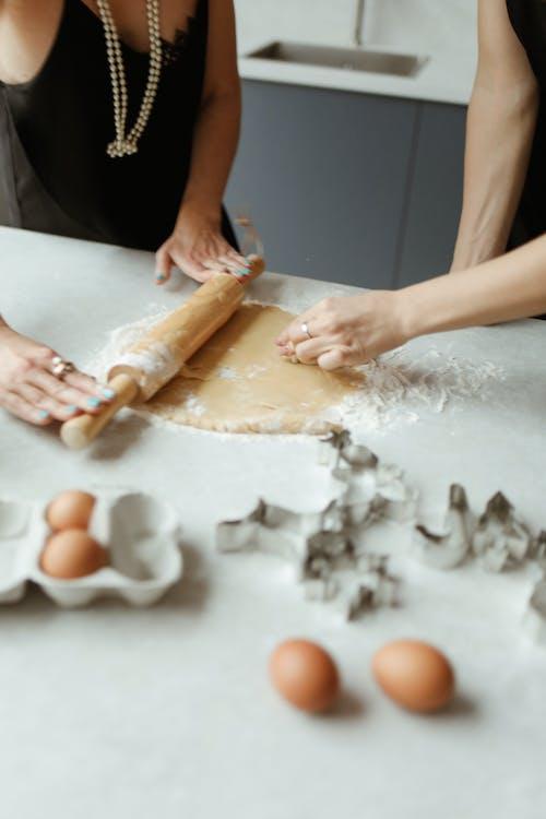 Two Women Preparing Dough For Cookies
