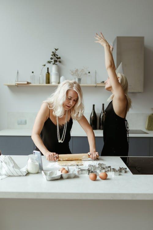 Woman Using A Rolling Pin For Making Dough