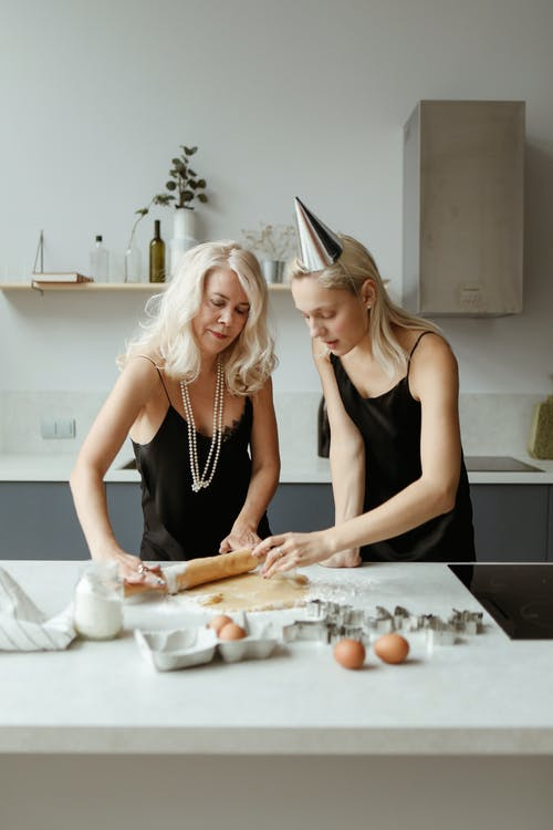 Mother And Daughter Preparing A Dough