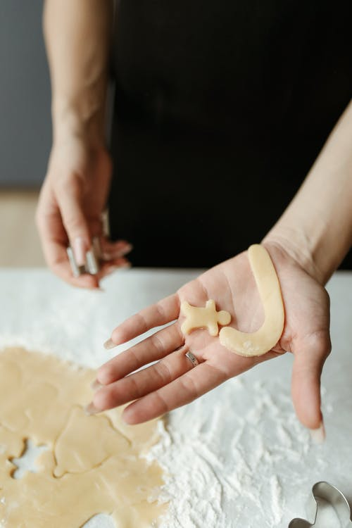 Person Making Cookies With Different Shape And Pattern