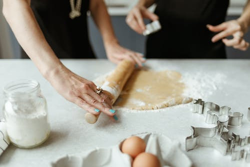 Person Using A Rolling Pin For Baking