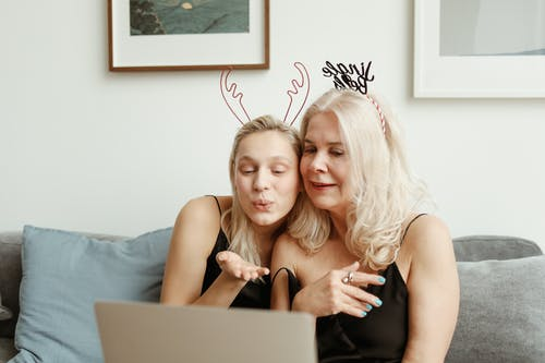Mother And Daughter Having A Video Chat