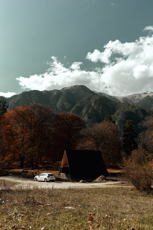 Lonesome house on valley in mountainous terrain