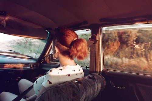 Unrecognizable female passenger riding in car