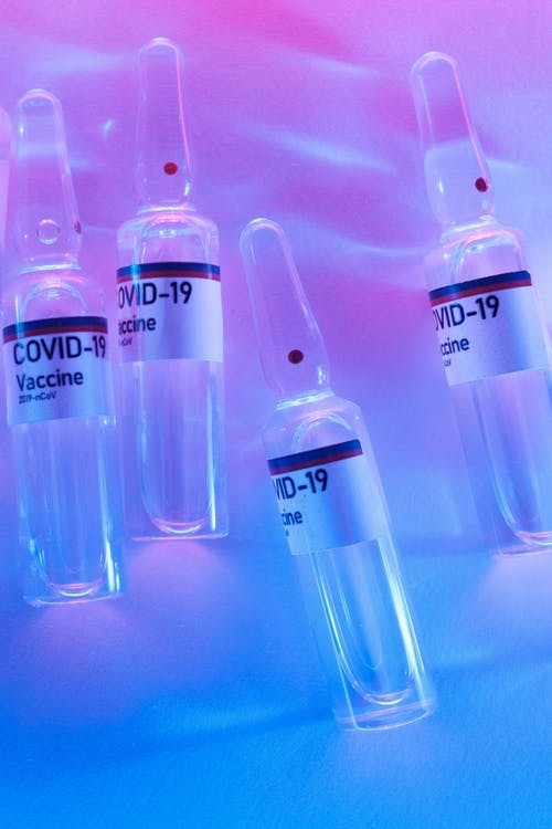 Vials sets with anti COVID vaccine in scientific laboratory