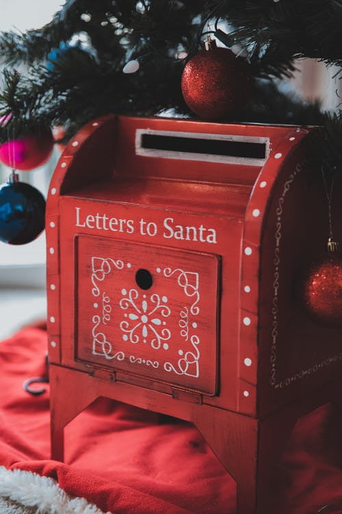Christmas decorated mailbox under tree