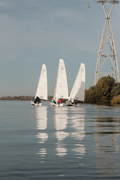 Yacht racing on calm lake on sunny autumn day