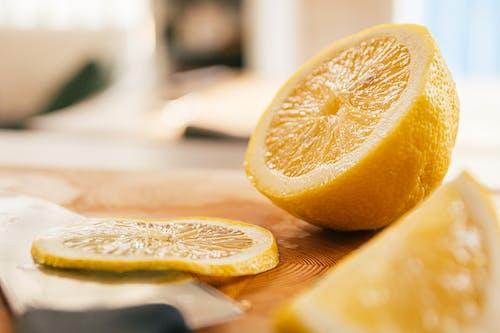 Close-Up Shot of Sliced Lemons on a Wooden Surface