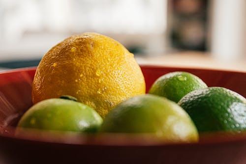 Close-Up Shot of Citrus Fruits on a Bowl