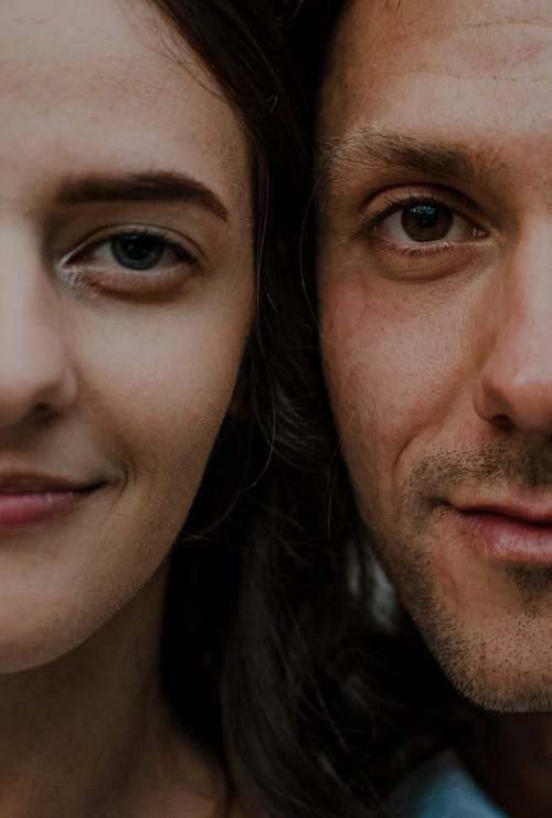Man and Woman Smiling Side by Side