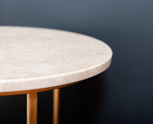 Round table against black wall