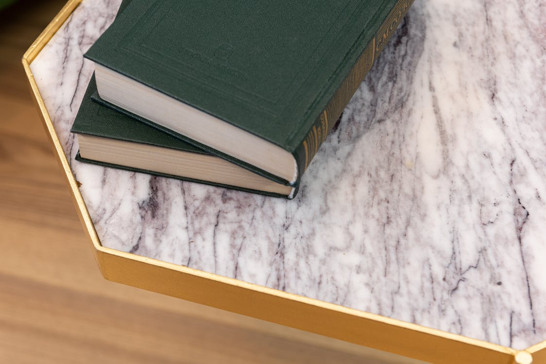 Old books placed on marble table