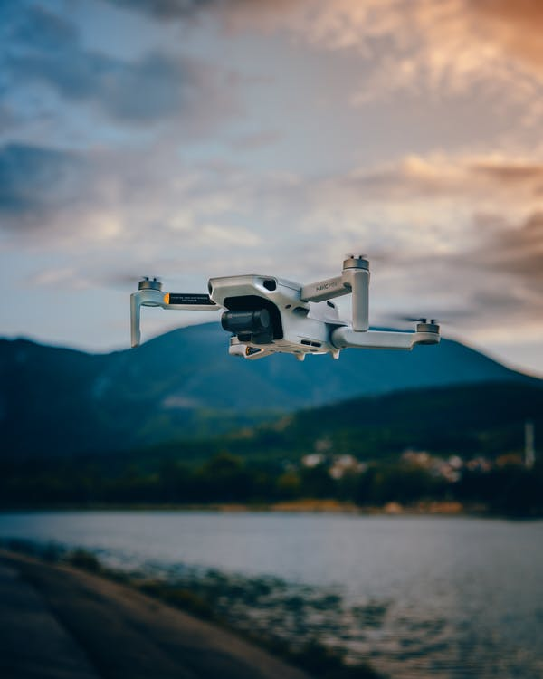 Professional drone flying against mountains