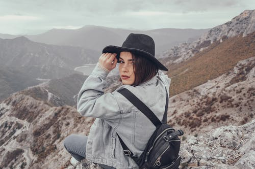 Traveling woman on mountain peak