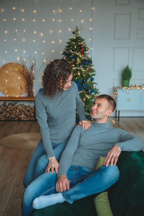 Happy couple relaxing on sofa in Christmas holidays