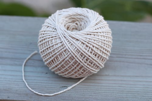 Ball of Yarn on Wooden Surface
