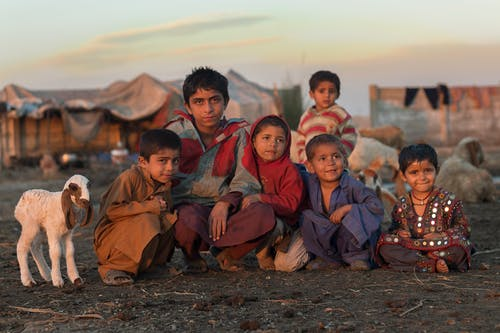 Group of Children Sitting Together on Ground