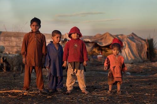 Group of Children Standing on Ground