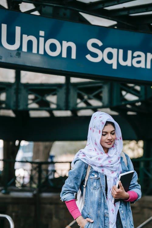 Muslim woman near subway station