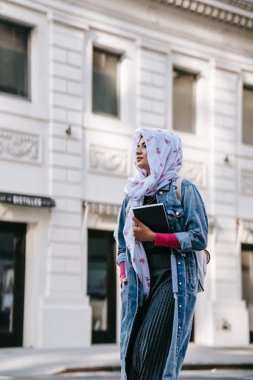 Ethnic woman walking along street