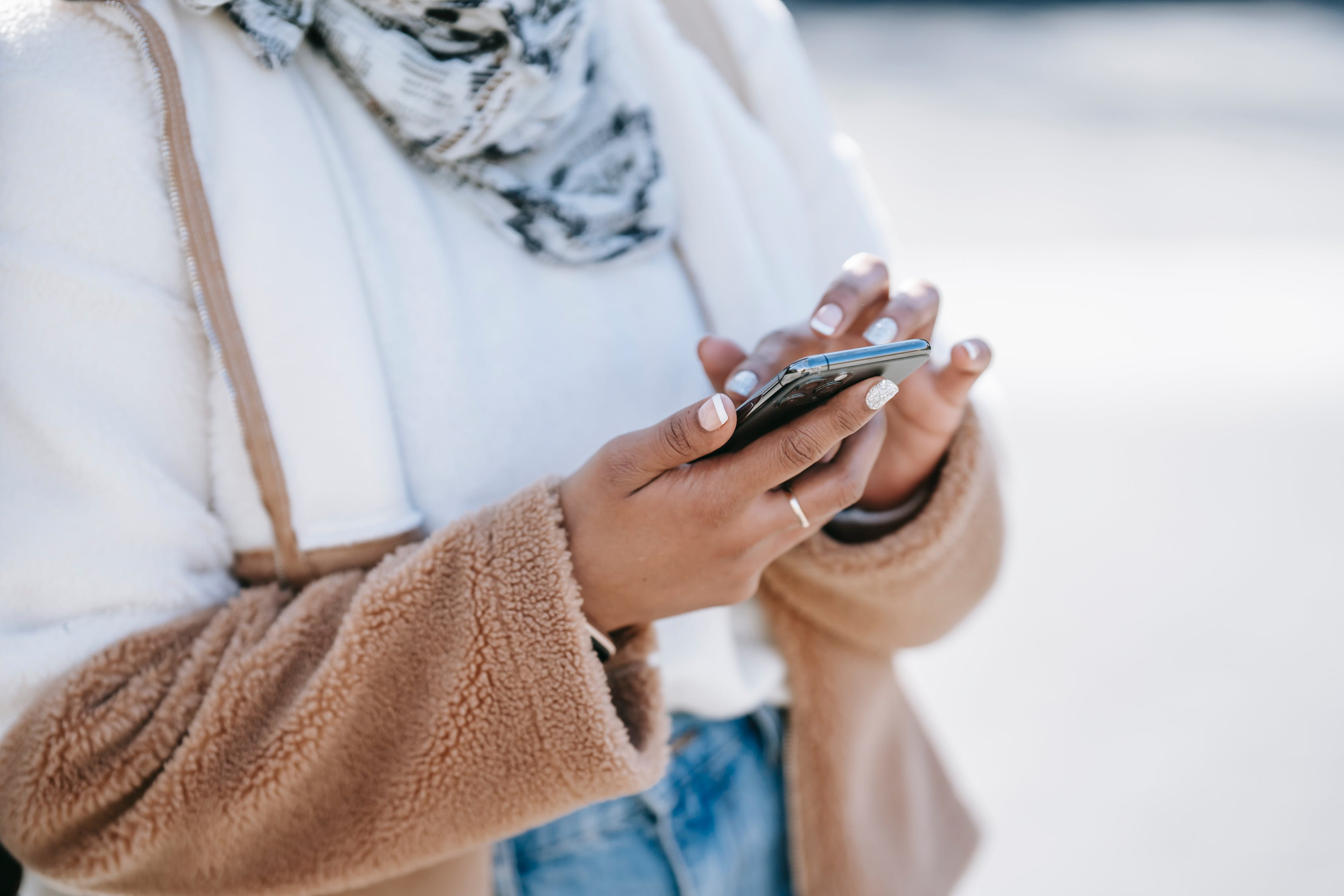 A close up on a woman using a smartphone. Photo used courtesy of Pexels.com