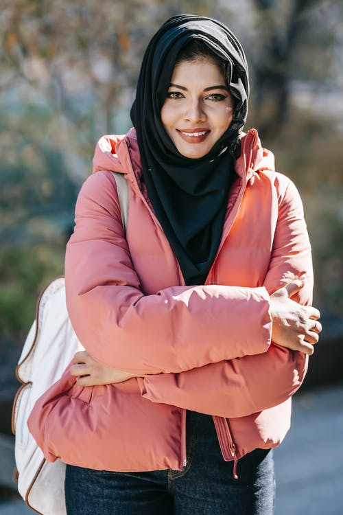 Smiling Muslim woman in park