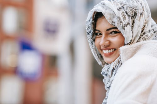 Ethnic woman in hijab in street