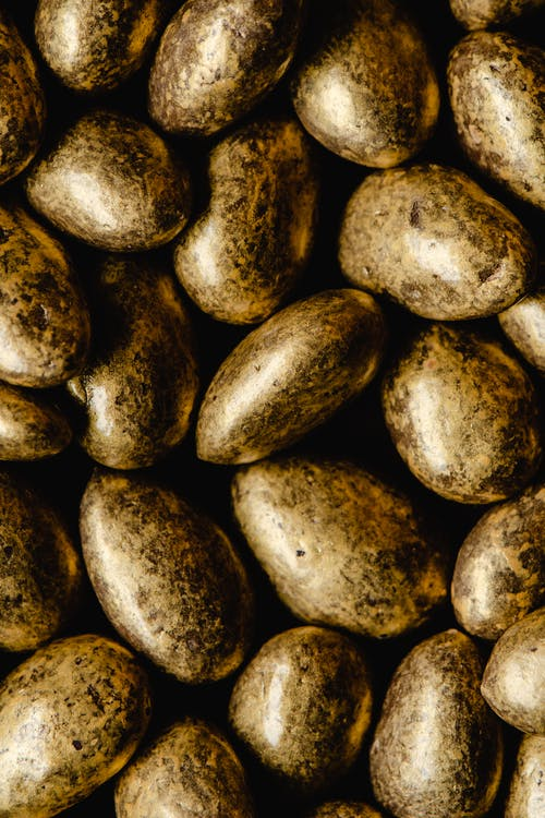 Close-Up Photo Of Gold Coated Almonds