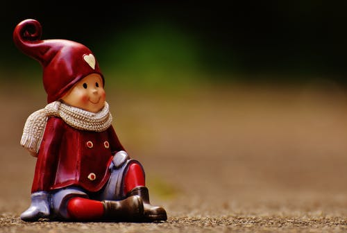 Figurine of Girl in Red Jacket with Brown Scarf