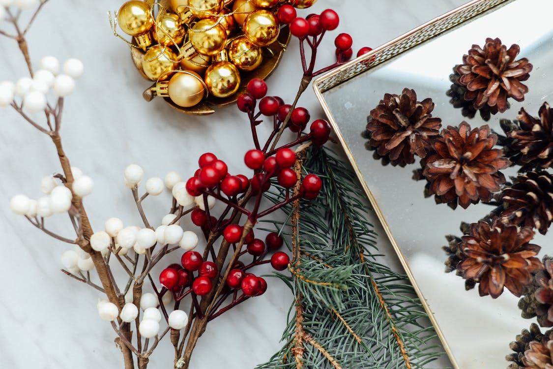 Gold And Red Baubles On White Surface