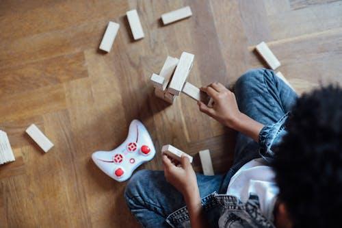 Person Holding Jenga Blocks