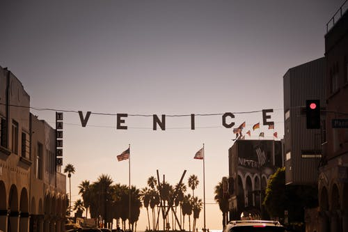 Venice Signage Hanging on Wire Near Traffic Light