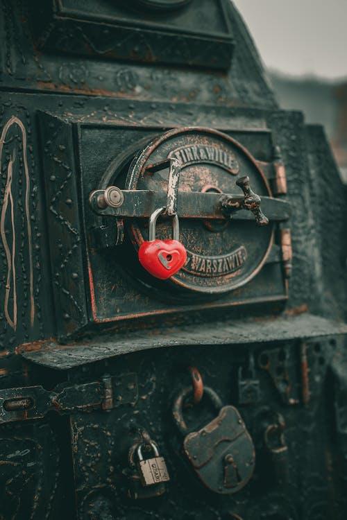 Red heart lock on old oven door