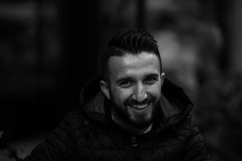 Man in Black Jacket Smiling