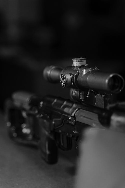 Black and Brown Rifle in Close Up Photography
