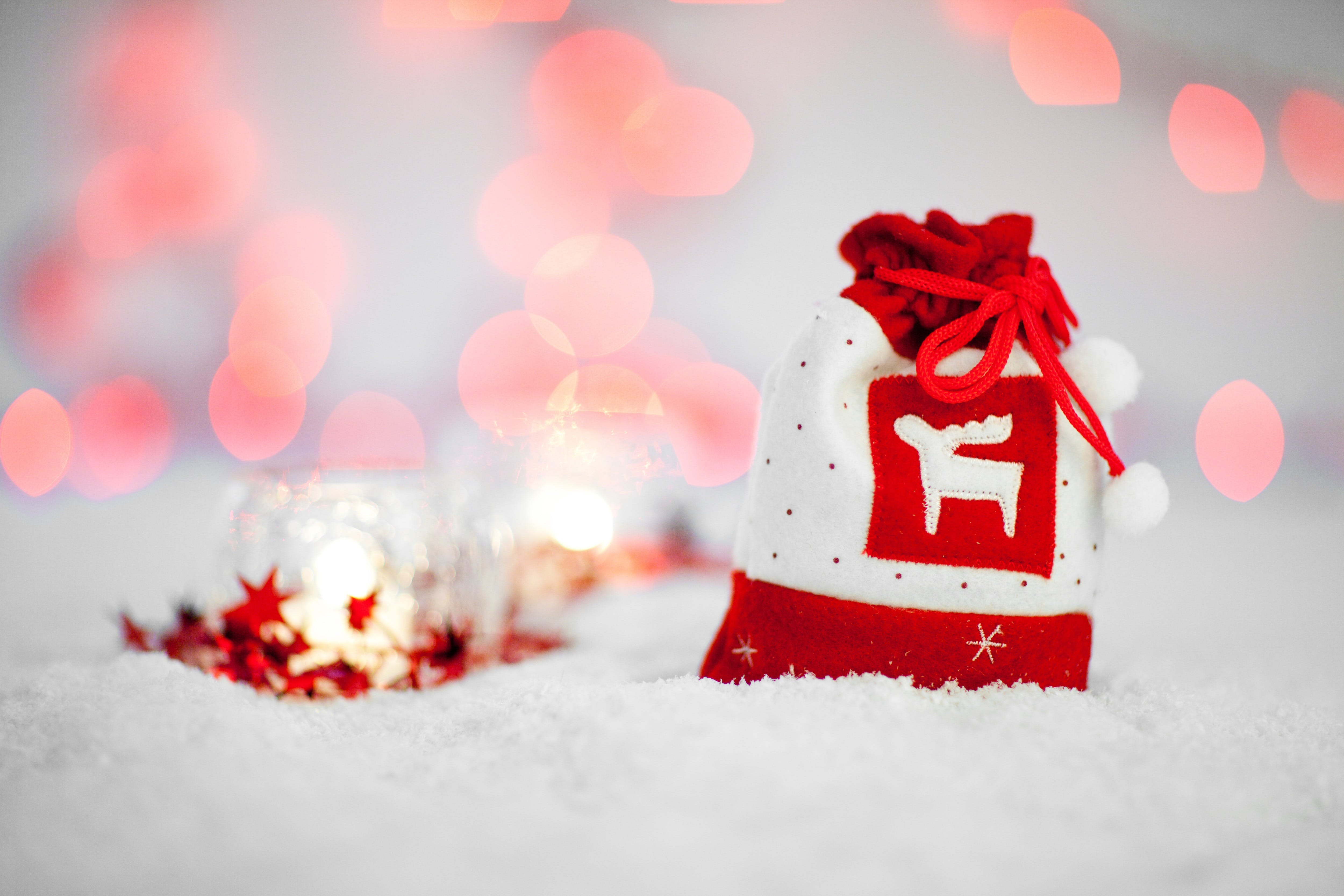 Red and White Christmas Pouch Bag on White Textile