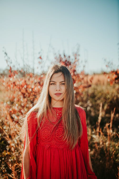 Woman with long hair in meadow