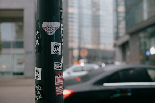 Stickers attached to pillar on city street
